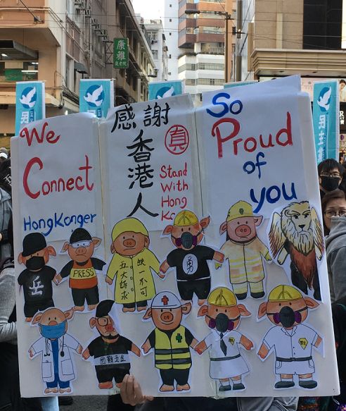 Protest sign in Hong Kong stating We connect and So Proud of You