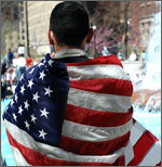 person with flag draped over shoulders